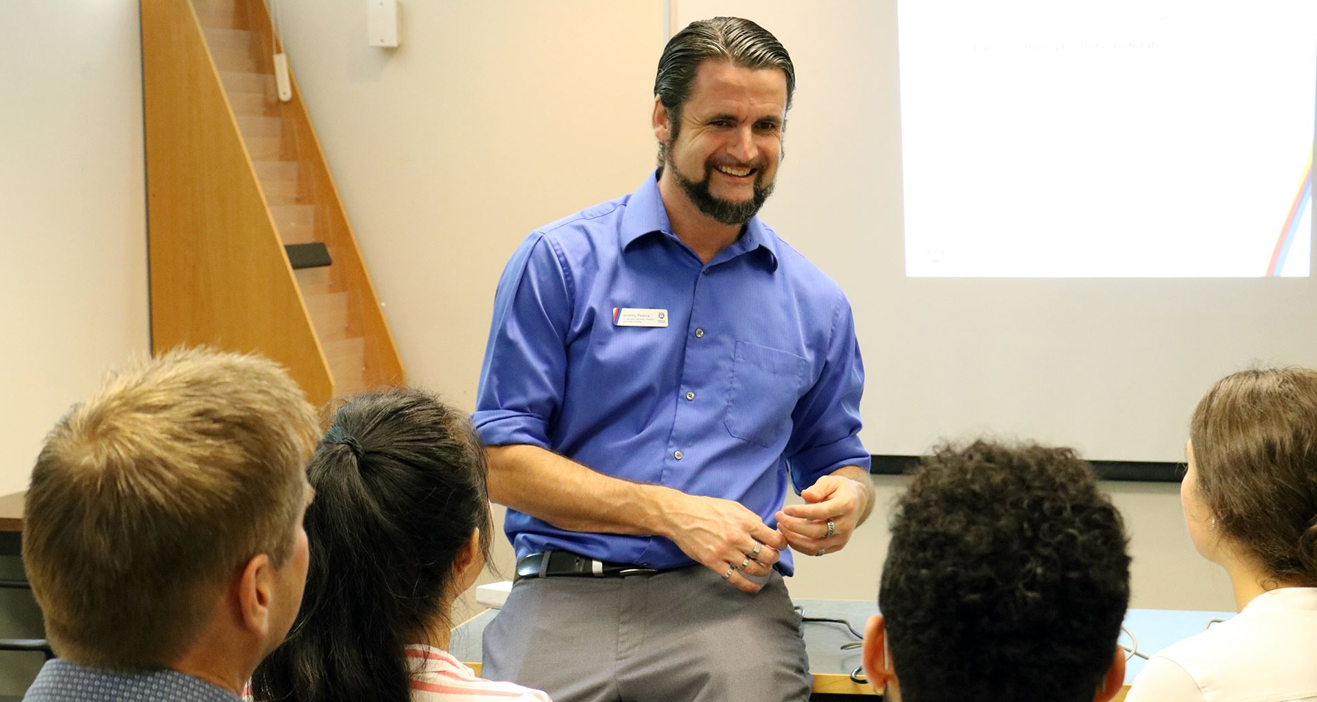 Career Educator engages with students at a career skills workshop.