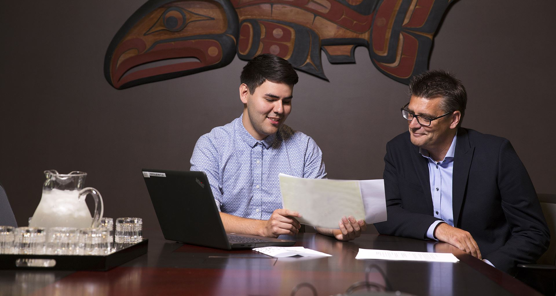 Indigenous student meets an employer in boardroom